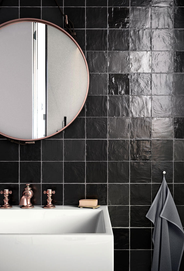 These Mallorca square ceramic tiles add a glossy black wall covering thanks to their gorgeous glazed finish.