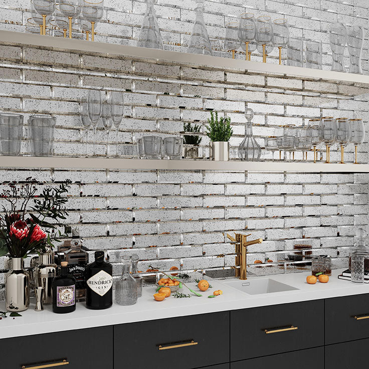 This counter-to-ceiling Beveled Antique Mirror Glass Tile adds a touch of vintage charm for a sophisticated kitchen or bathroom backsplash.