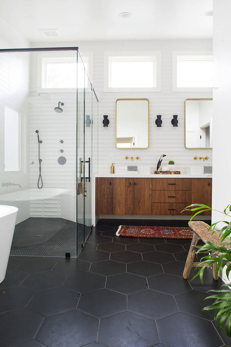 Large Black Hexagon Floor Tiles with Minimalist White Walls for a Contemporary Bathroom Design