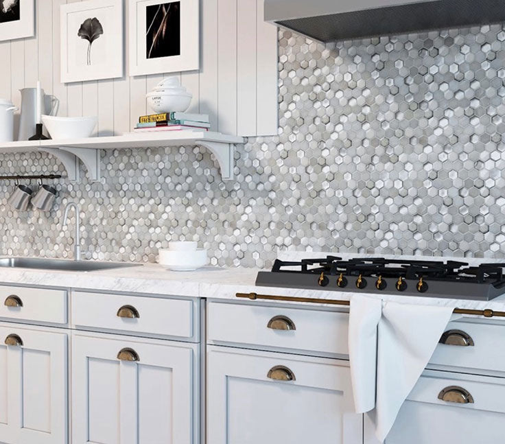 Add depth to an all-white kitchen with the mix of finishes in this White Ceramic And Pearl Glass Hexagon Mosaic Tile backsplash!
