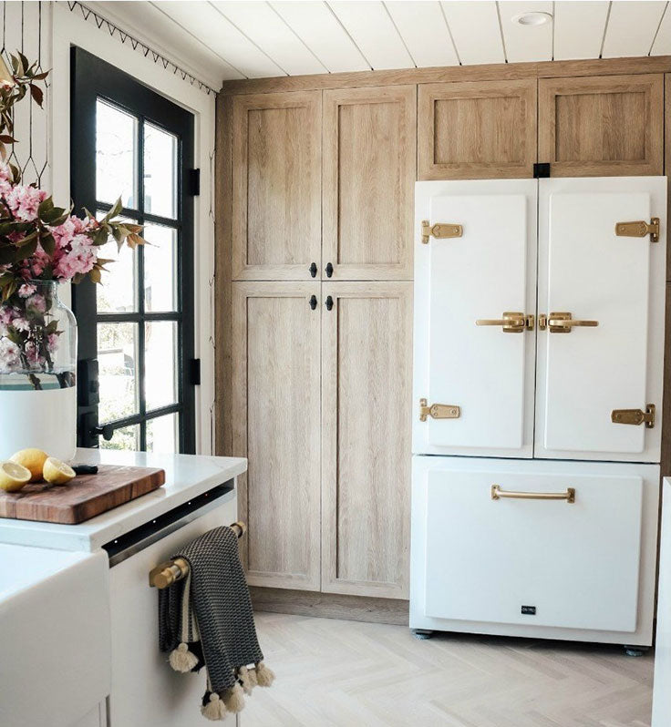 Nesting with Grace shaded their kitchen transformation, including these stunning semihandmade customized cabinets