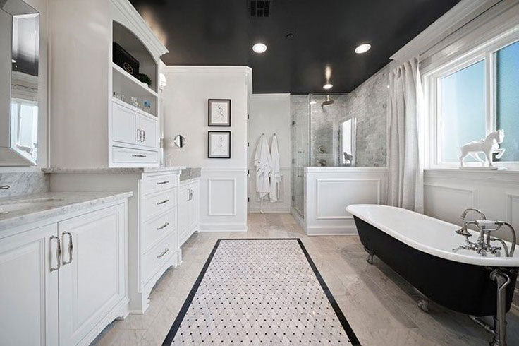 This contemporary black and white bathroom combines a Diamond Marble tile rug floor with a dark border