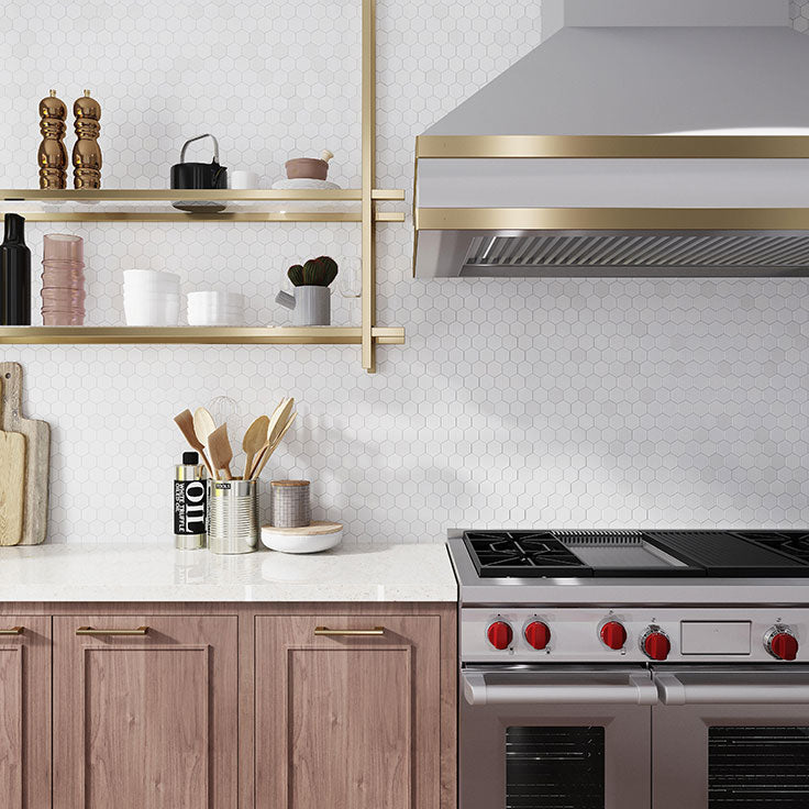 These French bistro glass and brass shelves were a custom design job to get the perfect match to the brass trim on the range hood