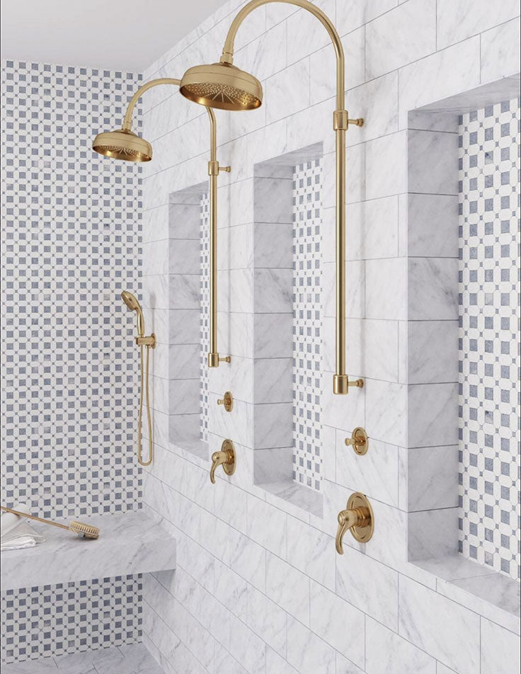 Blue and White Marble Shower with Mosaic Details and Brass Bathroom Fixtures