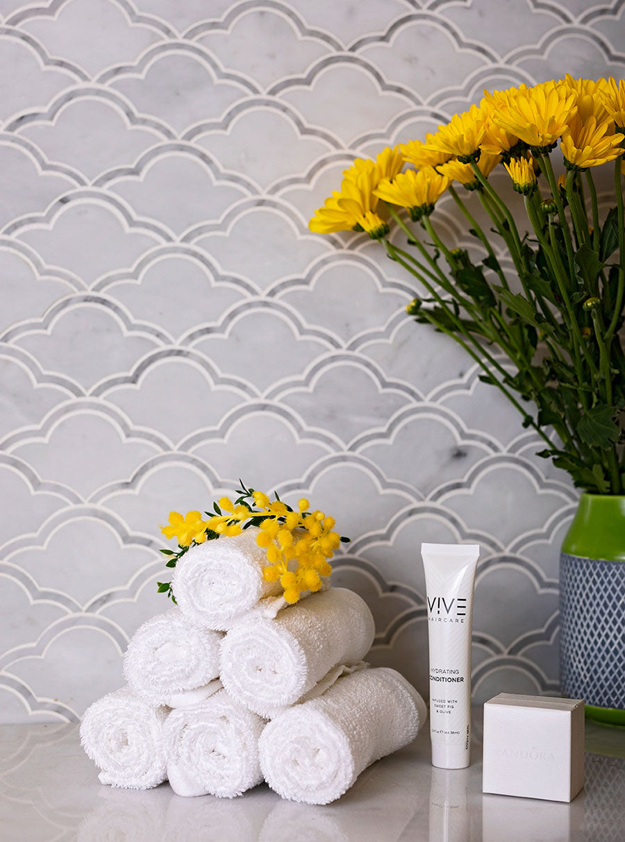 This soothing spa at home is possible with Carrara Clouds Marble Mosaic Tile
