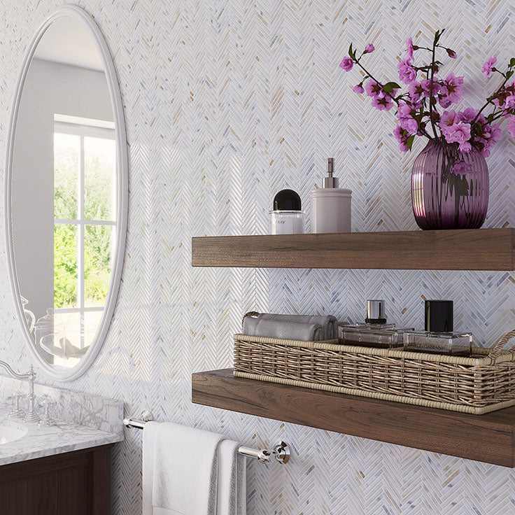 Neutral Bathroom Vanity Wall With Calacatta Gold Marble Herringbone Tiles and Floating Shelves
