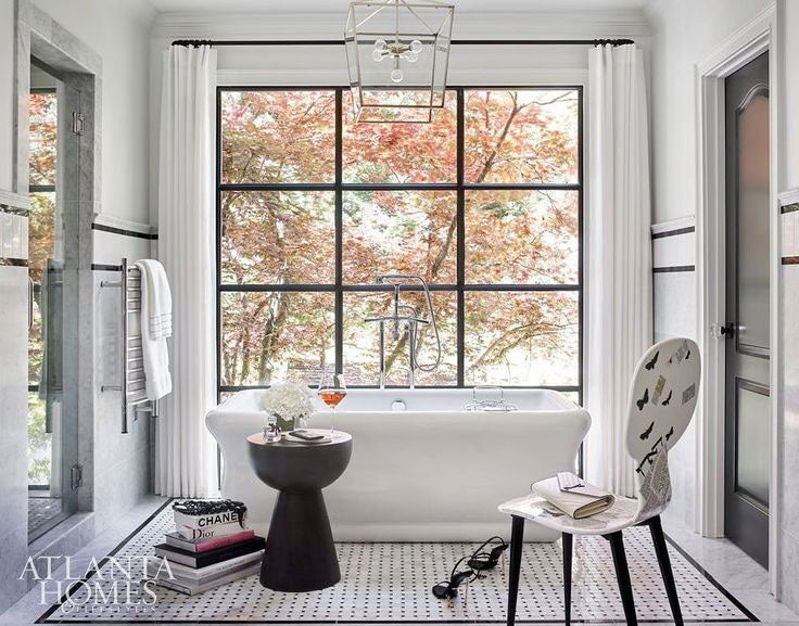 Luxurious Bathtub Design with a Patterned Floor Tile Rug Inlay