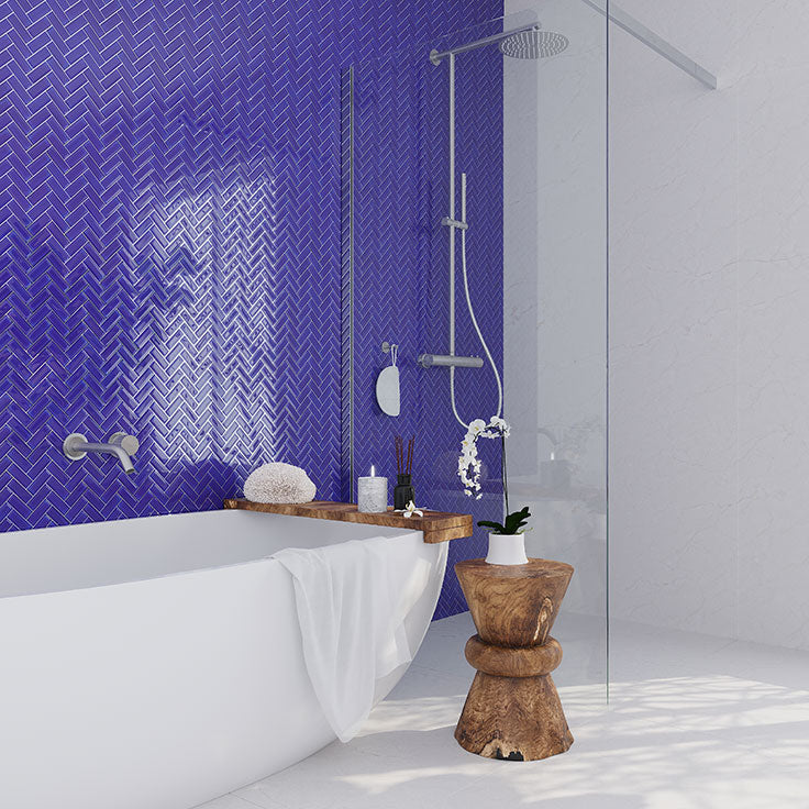 Between the timeless herringbone pattern and the eye-catching cobalt blue, this Herringbone Cobalt Blue Glass Tile backsplash makes it easy to add a designer look to your bathroom all on your own.