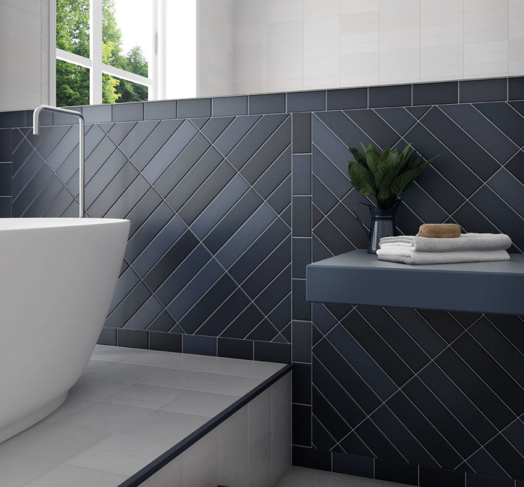 This subway tile layout throws all the patterns out the window and creates something unique and modern for a unique bathroom design!