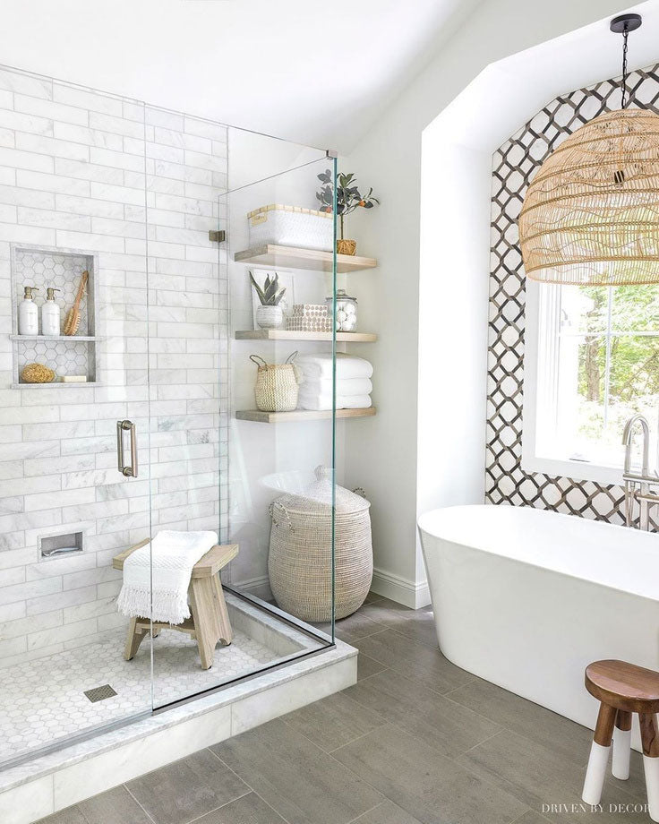 Driven by Decor demonstrates expert level tile mixing in their white and gray bathroom with a walk in spa shower