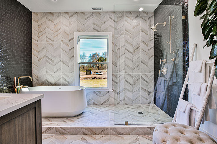Floor-to-ceiling tile flowed throughout the whole bathroom with a 4-foot shower on one side and a gorgeous, sleek freestanding bathtub on the other