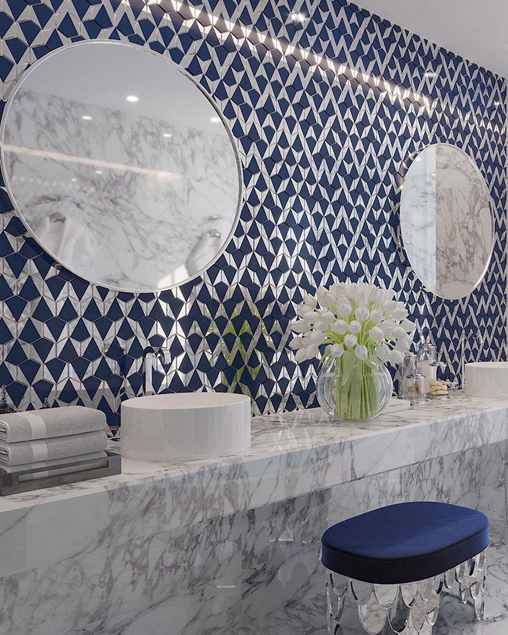 Vintage Glam Bathroom Vanity Tile Accent Wall in Blue and Silver with a Marble Countertop