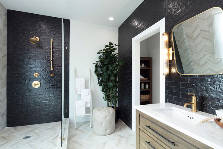 AFTER: This black and white bathroom remodel on HGTV used Tile Club's Ceramic and Porcelain Tiles