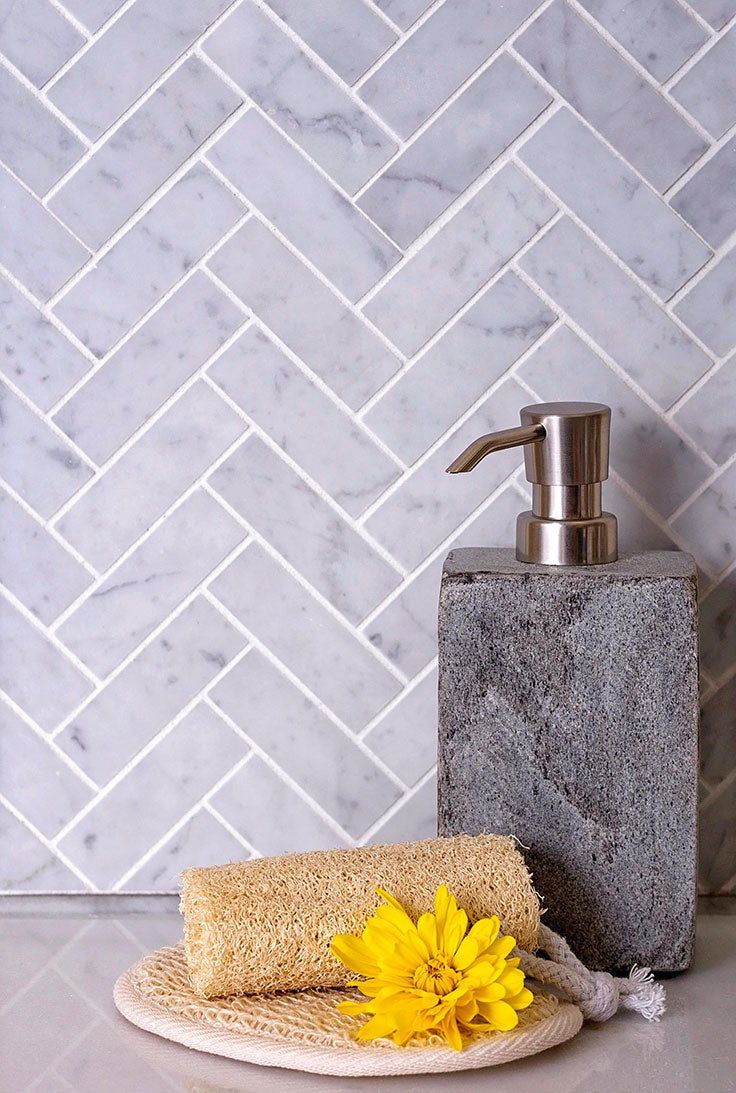 Matte marble - like our honed Carrara Herringbone mosaic tiles - adds a gorgeous finish to any interior!