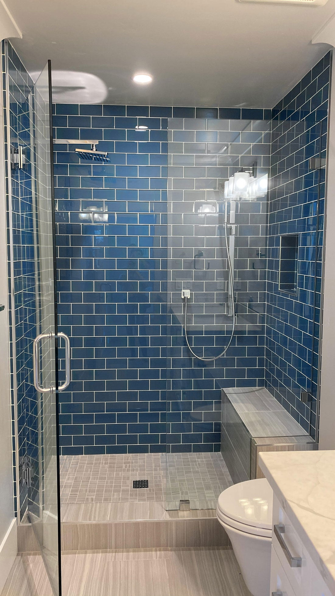 "You can't go wrong with a classic shower wall like our Glacier Ocean Blue 3"" x 6"" Polished Glass Tile in a running bond - but it's nice to have so many creative subway tile pattern ideas to try if you want something a little unique!"