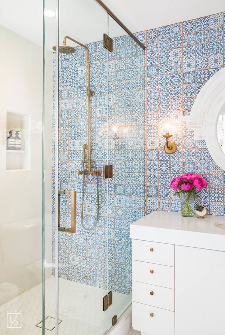 Moroccan-inspired blue and white tile shower accent wall