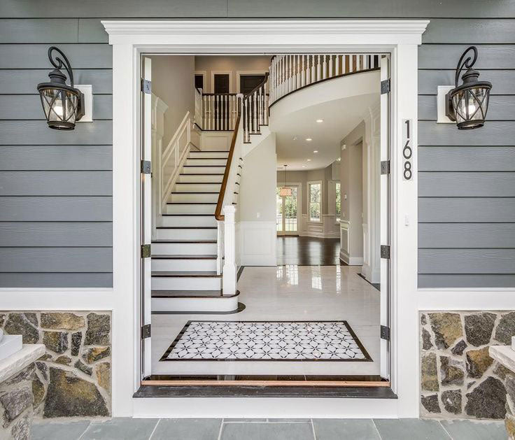 Entryway flooring design with a patterned tile rug - a stunning way to welcome guests to your home