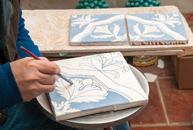How can you create your own hand painted tile designs?