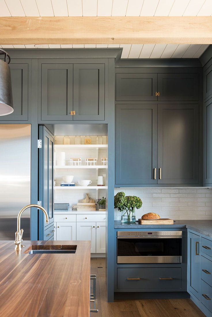 Kitchen Cabinets hide a Seamless Butler's Pantry Built In