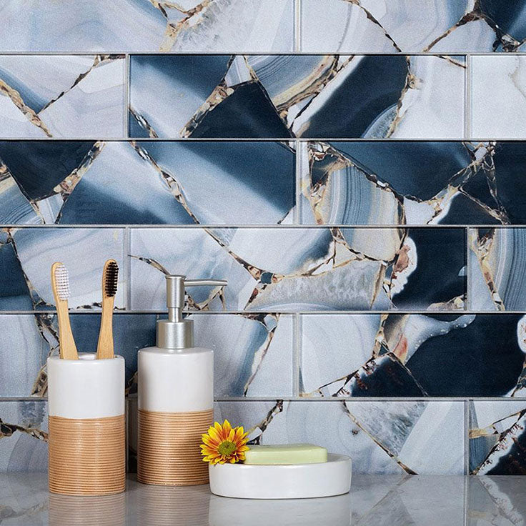 This Quartz Geode and Midnight Blue Glass Tile backsplash is a true example of how versatile glass tile really is.