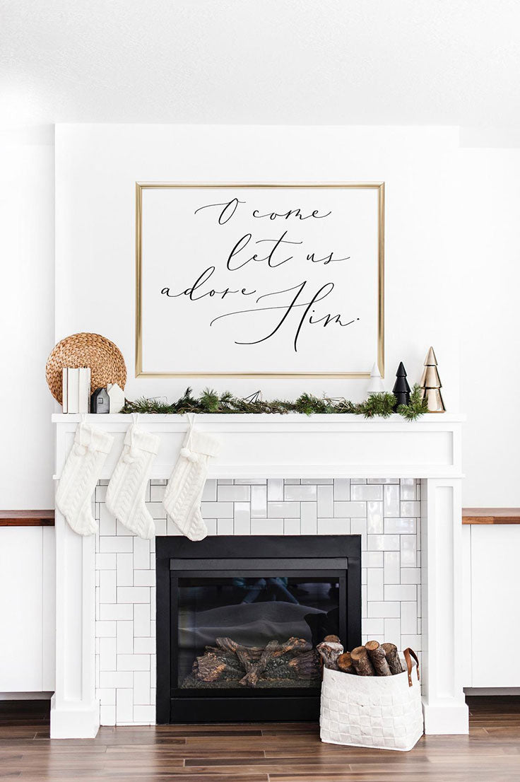 Herringbone Subway Tile Layout for a Modern Minimalist Fireplace Design with Hand Lettered Christmas Signs on the Mantel
