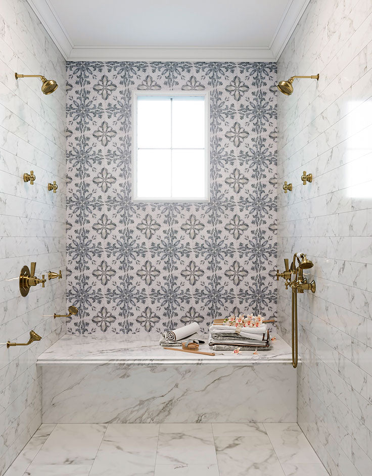 Mediterranean Bathroom Style with a Marble Mosaic Wall and Calacatta Bench and Floor