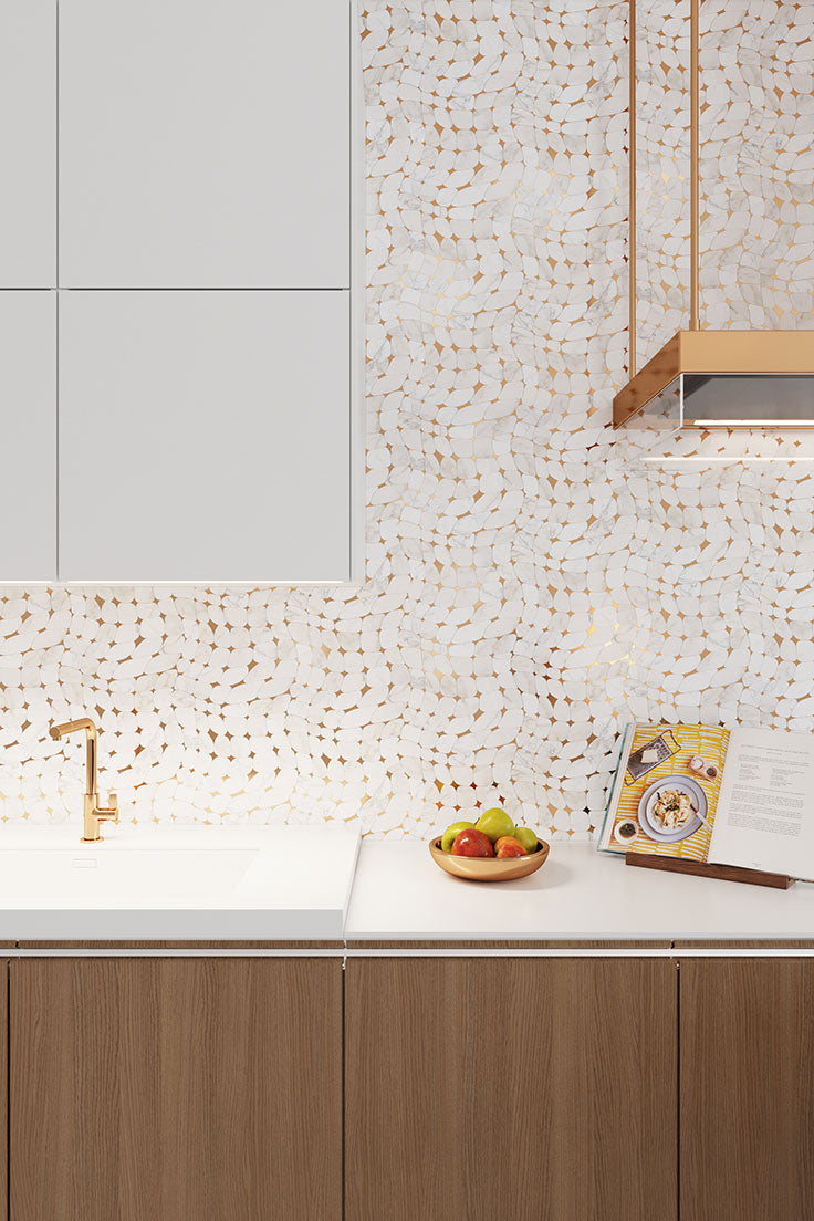 Golden Stars Calacatta Gold and Brass Mosaic Tile create abstract art on the kitchen wall