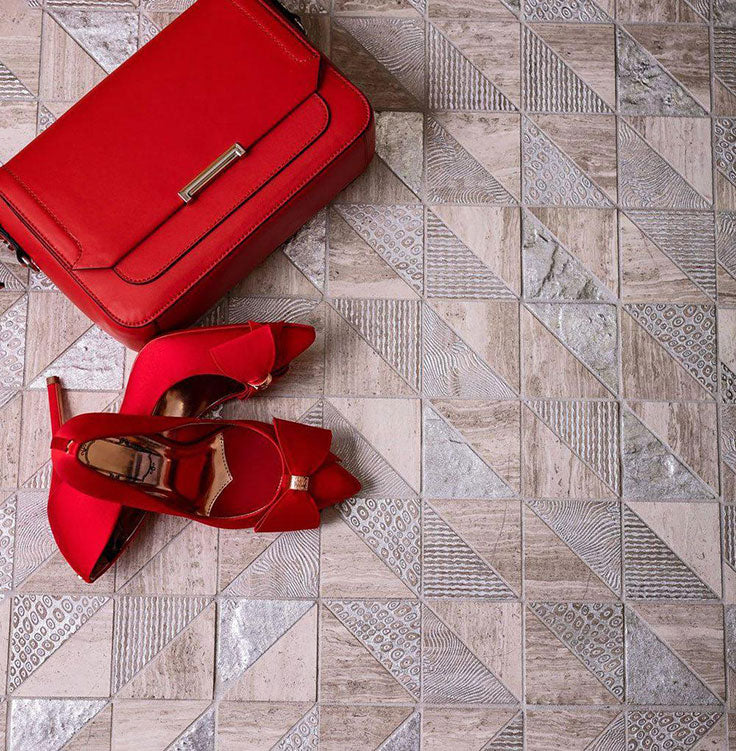 Lean into the look and texture of natural wood with the Silvery Grey Triangles Wooden Beige Marble Mosaic Tiles
