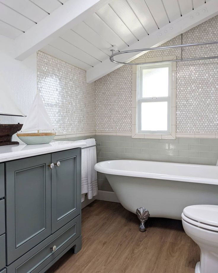 Glam Coastal Bathroom with Mother of Pearl Hexagon Tiles Paired with Sea Glass Green Subway Tiles