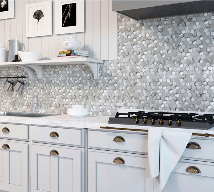 Since many glass tile backsplash options come in sheets, installation is extremely easy, which means you can start enjoying a backsplash like this White Ceramic and Pearl Glass Hexagon Mosaic Tile backsplash in no time!