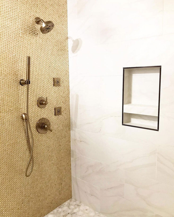 Pairing Tiles for a Calacatta Gold Marble Shower with a Glass Penny Round Accent Wall by My Home Reno