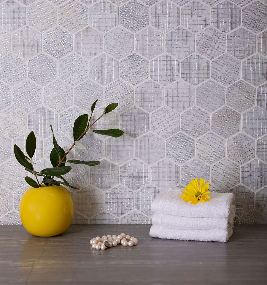 This silver etched hexagon tile combines a trendy grey color and subtle engraved details that add a hint of metallic sparkle gives your home a unique character.