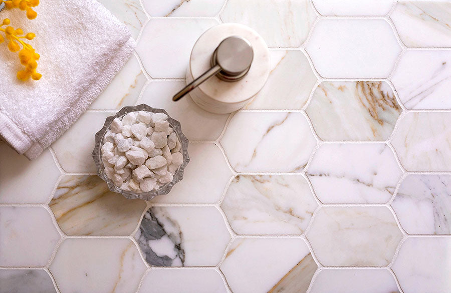 Bring out the natural beauty of your marble shower tiles like Calacatta Gold Elongated Hexagon Mosaic Tile - and banish the stains!