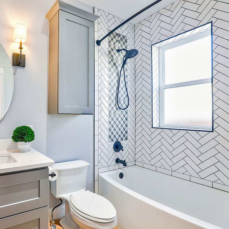 Traditional Ceramic Subway Tile Shower Wall in a Herringbone Layout