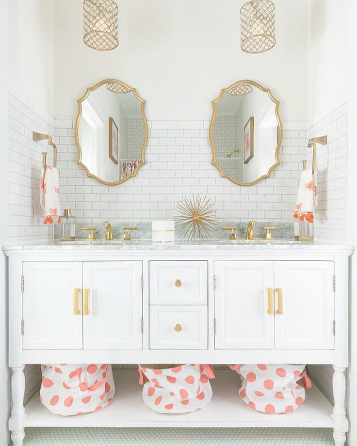 Adorable White Vanity with Gold Framed Mirrors and White Glass Subway Tile Backsplash