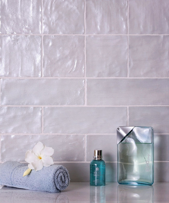 Adding a pop of pale blue with Mallorca Grey 2.5 x 8 Ceramic Tile can bring an incredibly relaxing vibe to your shower design