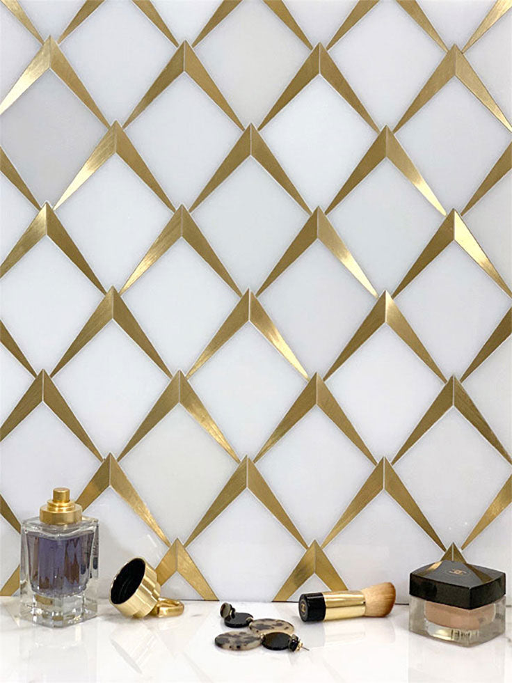 Arrowhead Brass Marble Mosaic Tile behind a makeup vanity created the perfect luxe backdrop