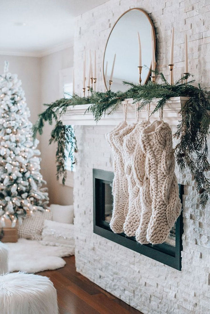 White Brick Fireplace with Cable Knit Stockings and a Flocked Christmas Tree