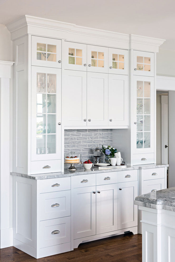 This cleverly designed kitchen storage hutch by Lewis & Weldon Custom Kitchens features a combination of cupboards and counter space for a coffee bar