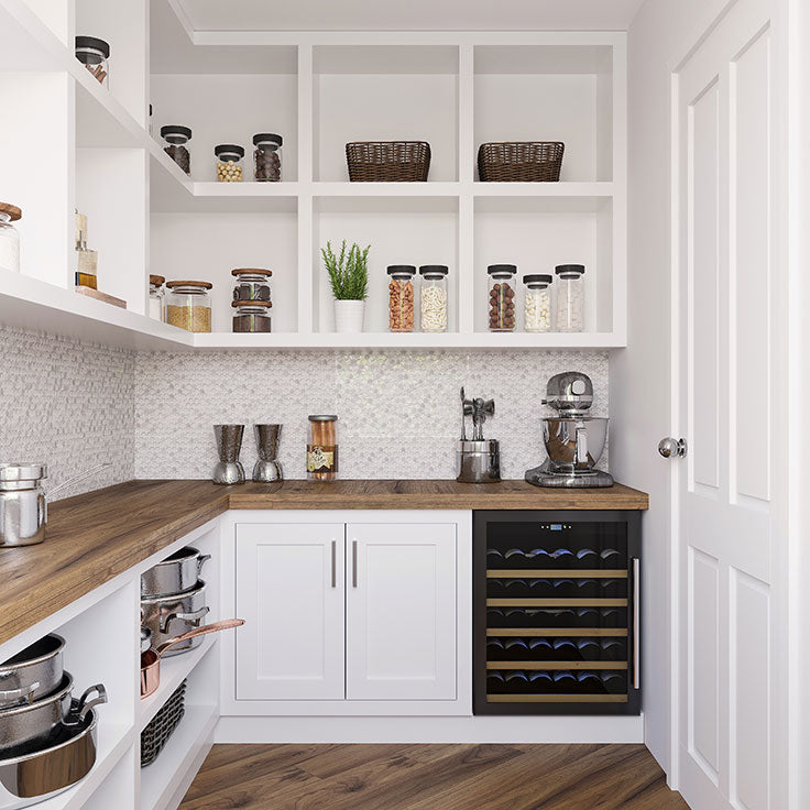 We especially love how this Ice Cold Penny Round White Glass Bianco Carrara Tile backsplash  enhances the all-white and natural wood décor scheme in this walk-in pantry