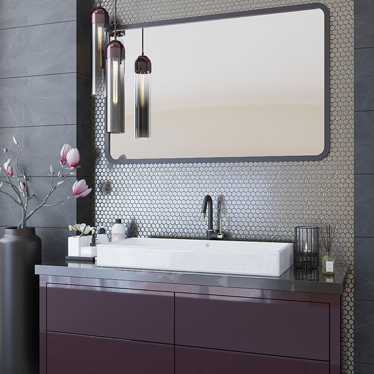 This Master Bathroom embraces minimalist style with the modern vanity and vessel sink, while adding a strong sense of design with deep plum, charcoal, and glossy silver tile accents