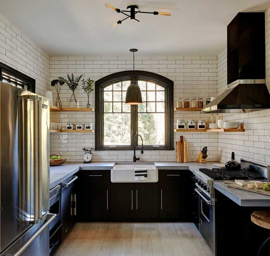 Industrial Farmhouse Kitchen Decor with wrought iron, espresso stained wood, and charcoal gray grout accenting white subway tiles