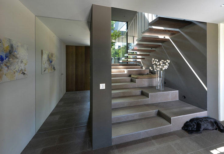 Contemporary Home Entryway with Gray Stone Tile Stairs