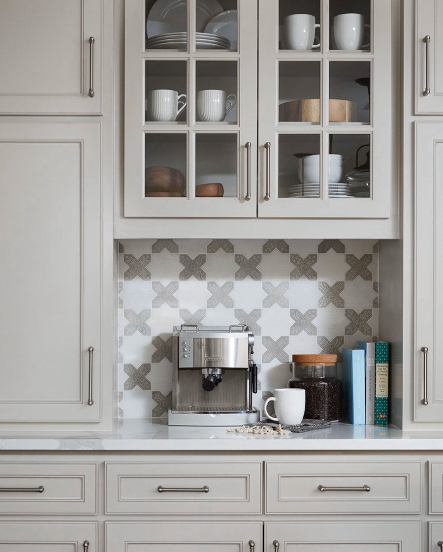 Create a coffee bar in the corner of your kitchen or living area by painting an old vintage dresser, adding a wood or stone top and open shelving with some stylish tile in the background