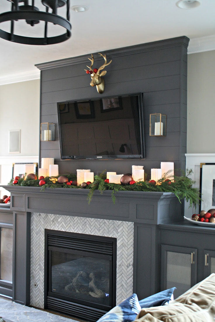 Dark Shiplap Fireplace with Marble Herringbone Tile and DIY Christmas Candle Mantel Decor
