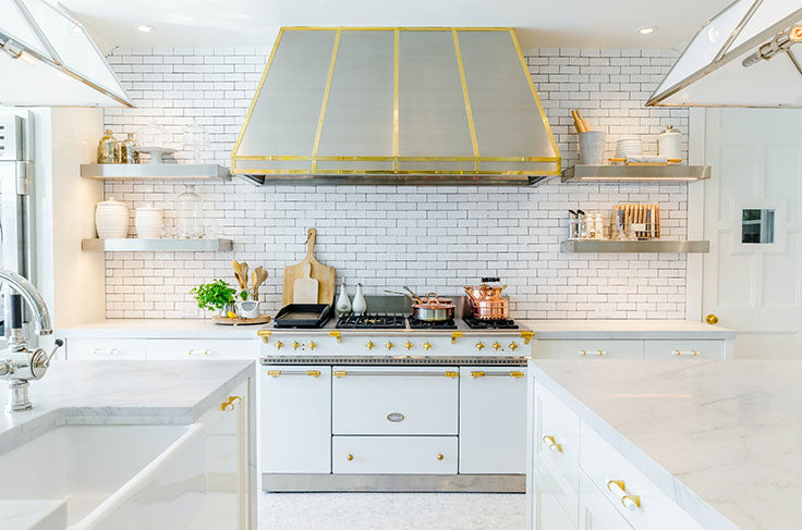 Brass and White French Country Kitchen with Black and White Grout