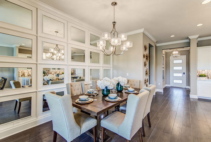 Luxe Dining Area with a Mirror Wall by Tampa Builders Sunrise Homes