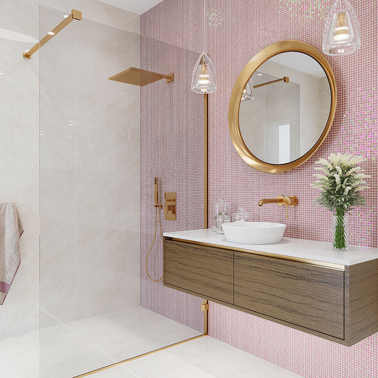 Peach Glass Bathroom Tiles with Brass Mirror and Fixtures