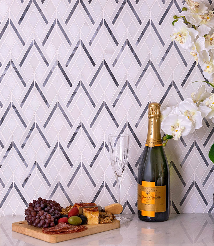 Triangular Backsplash Tile in White and Gray Marble adds Geometric Flair to a Gorgeous Kitchen