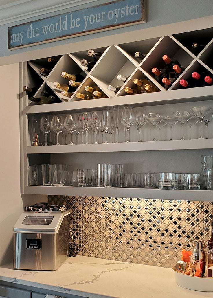 Silver Cross and Mirror Squares Mosaic Tile enhances the under cabinet lighting in this wine bar backsplash